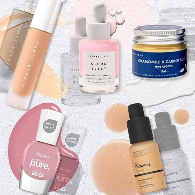 vegan beauty products set against a stony backdrop with smudges of product behind them