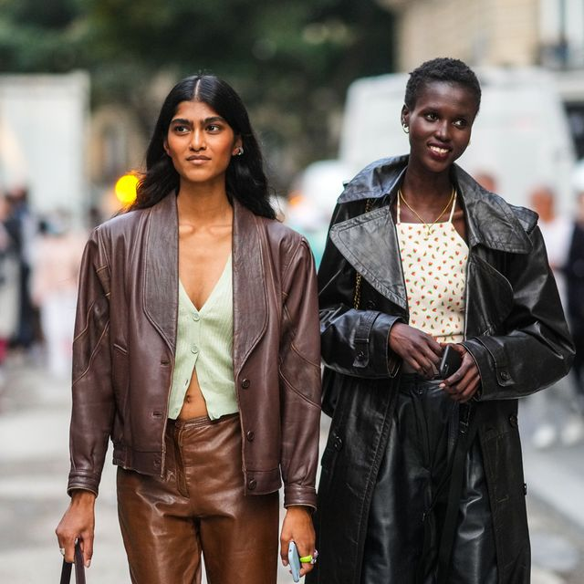 four women at haute couture fashion week wearing leather blazers for women