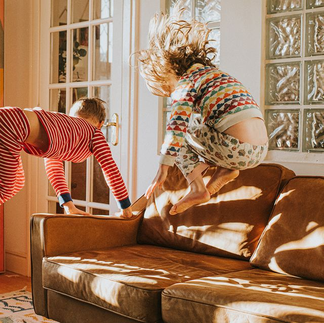 kids jumping on leather sofa