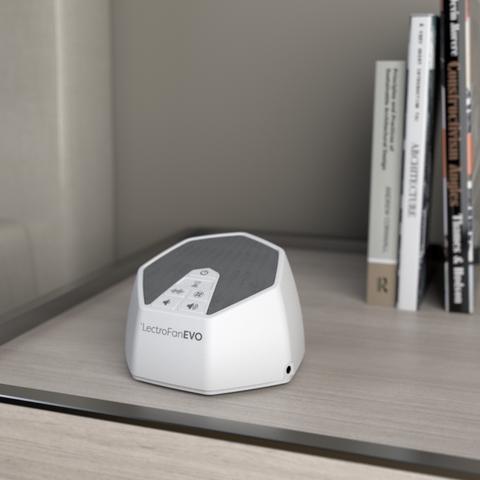 lectrofan evo white noise machine on a bedside table