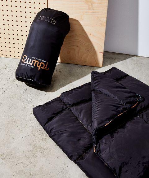 Punching bag, Floor, Room, Sleeping bag, Bag,