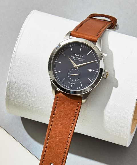 Analog watch, Watch, Strap, Watch accessory, Fashion accessory, Tan, Jewellery, Brand, Material property, Leather,