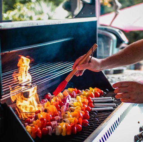 guy grilling veggie skewers