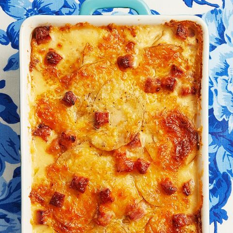 scalloped potatoes and ham on blue floral linen