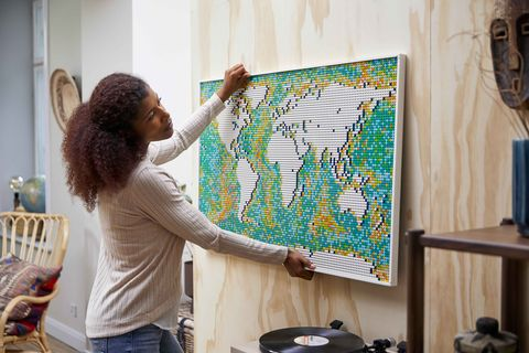 a couple using the lego world map