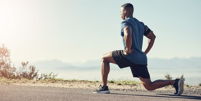 shot of a young handsome man doing lunges outdoors