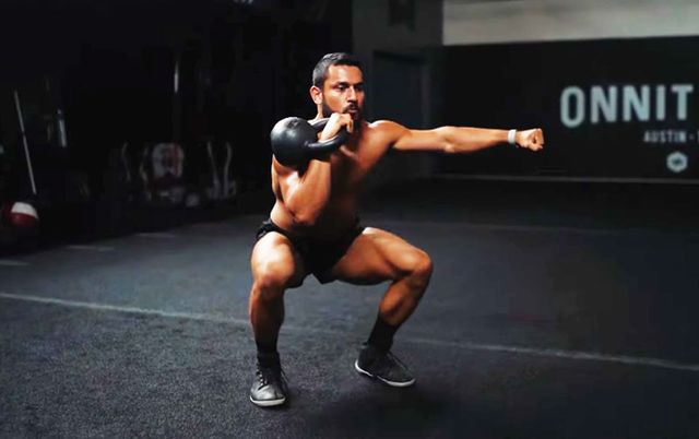 man exercising with kettlebell