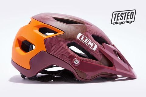 Helmet, Personal protective equipment, Clothing, Sports gear, Motorcycle helmet, Orange, Headgear, Headgear, Bicycle helmet, Magenta,