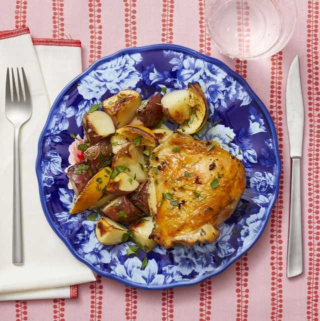lemon thyme sheet pan chicken and potatoes on blue plate