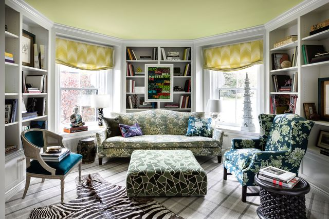 sitting room with green floral furniture and accents