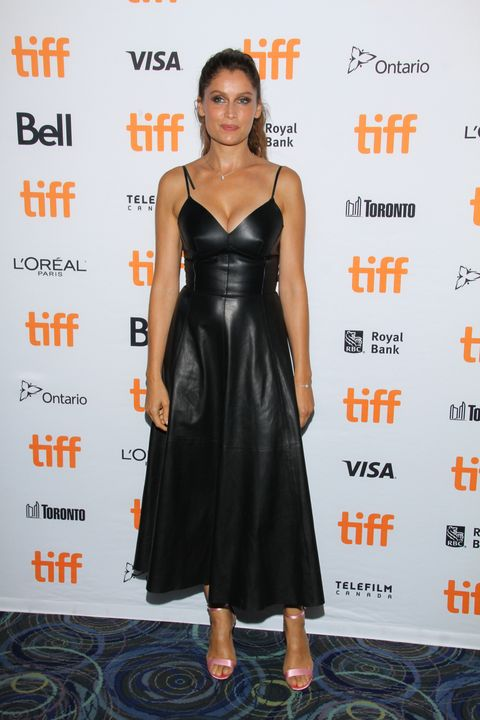 Clothing, Dress, Cocktail dress, Little black dress, Shoulder, Premiere, Fashion, Fashion model, Carpet, Footwear,