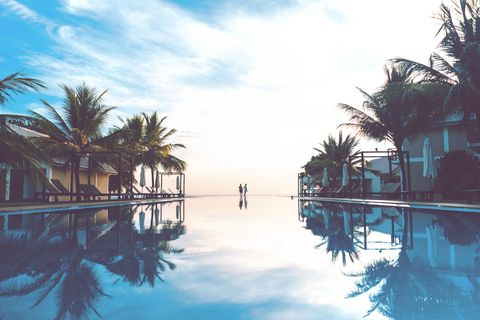 Sky, Water, Resort, Tree, Reflection, Swimming pool, Palm tree, Waterway, Vacation, Arecales,
