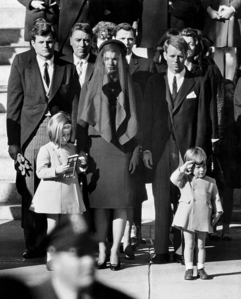 The famous image of Kennedy as a toddler saluting his father's casket during his funeral procession.