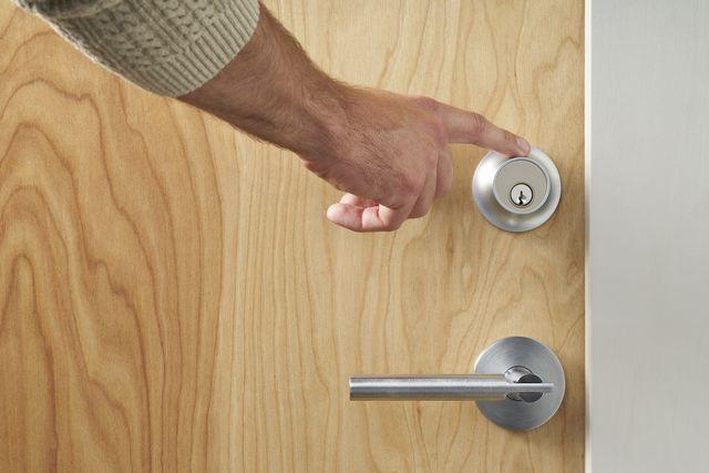 hand touching lock