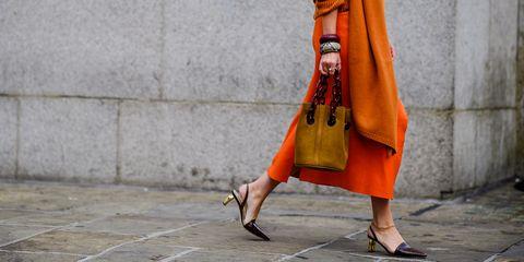 Clothing, Street fashion, Orange, Yellow, Outerwear, Fashion, Dress, Leg, Shawl, Textile,