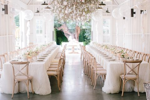 White, Chair, Photograph, Furniture, Chiavari chair, Table, Room, Yellow, Lighting, Function hall,
