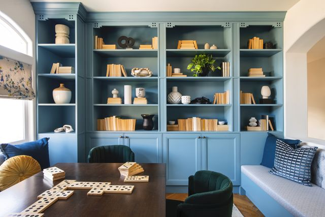 game room with built in shelving painted in light blue