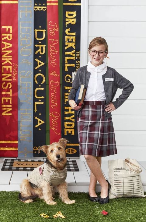 librarian assistant dog costume with ribbed sweater, monocle, and name tag