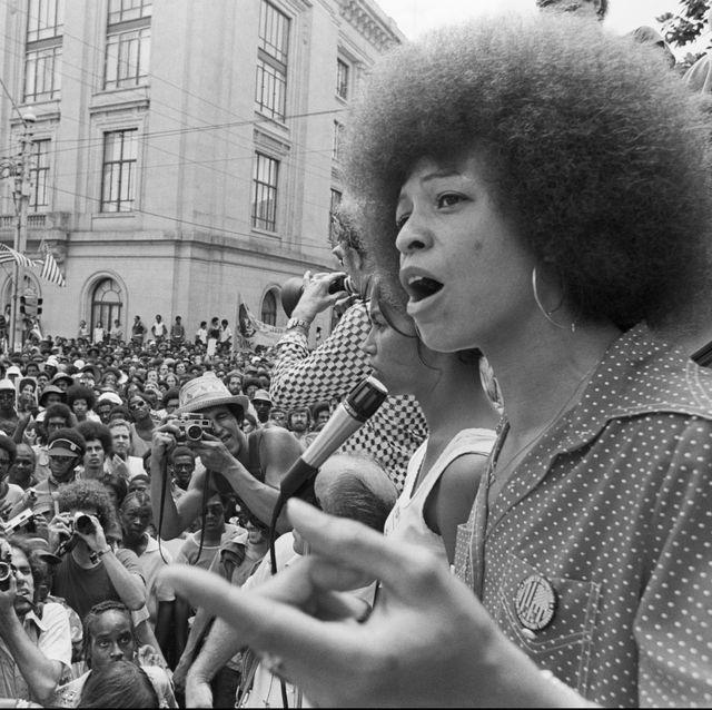 radical political activist angela davis speaks at a street rally in raleigh