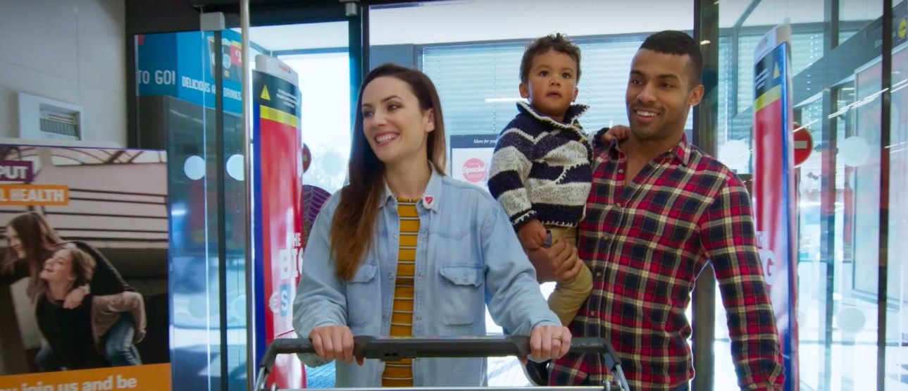Mixed-race couple in a Lidl advert flee country after racist abuse