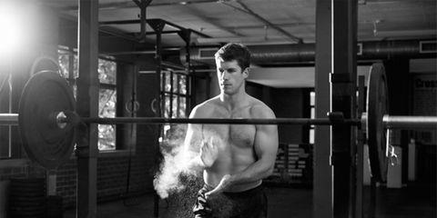 man preparing to weightlift