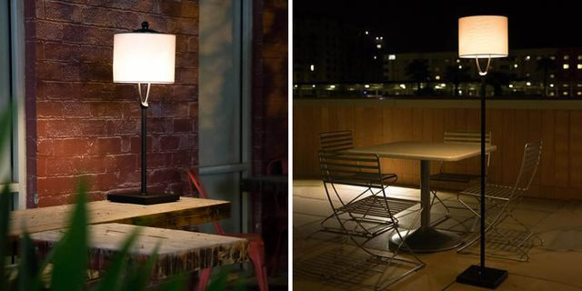 lamp outside in front of brick wall, lamp next to outdoor seating and table