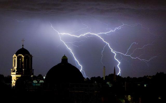 lightning strikes over london skyline