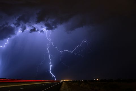 Lightning strikes during a nighttime thunderstorm