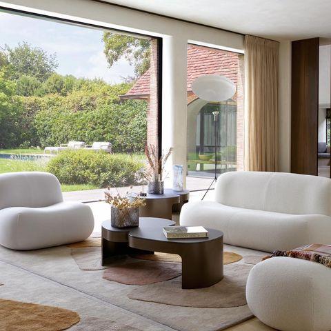 ligne roset living room with pukka sofa, armchair, footstool, table, rug