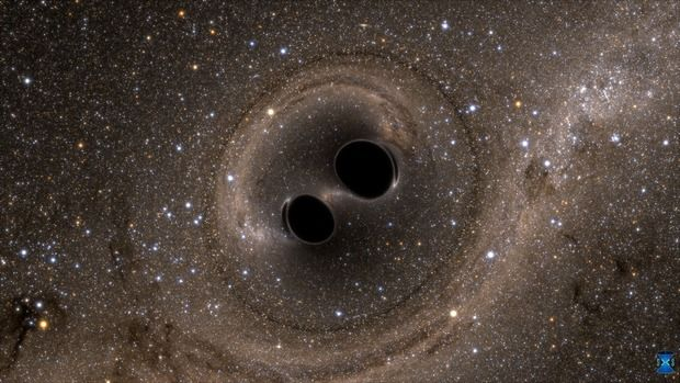 Two Black Holes Are Merging at the Center of a Distant Galaxy