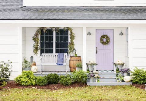 lilac front door on a white house
