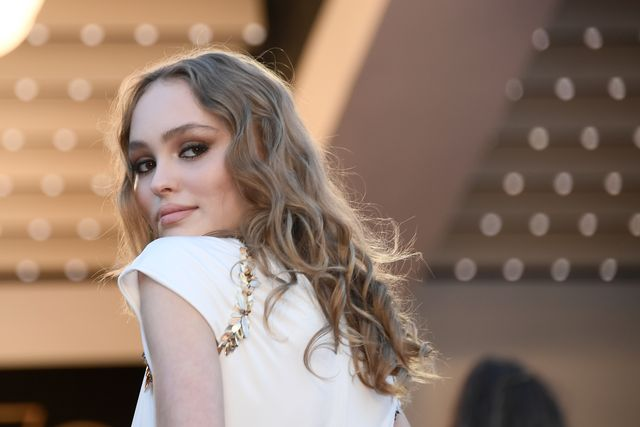 topshot   french us model and actress lily rose depp poses as she arrives on may 17, 2017 for the screening of the film ismaels ghosts during the opening ceremony of the 70th edition of the cannes film festival in cannes, southern france   afp photo  anne christine poujoulat        photo credit should read anne christine poujoulatafp via getty images