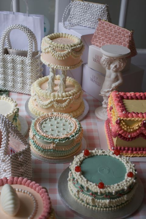pastel colour cake and handbag selection for lily vanilli birthday event