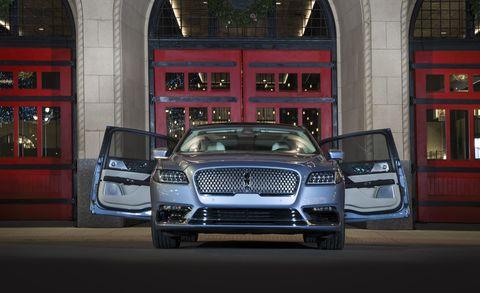 Vehicle, Car, Automotive design, Red, Architecture, Luxury vehicle, Mid-size car, Automotive exterior, Building, City car,