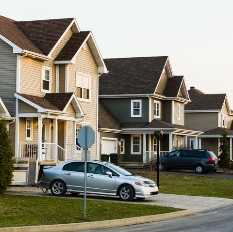 line of suburb homes each with a car parked in the driveway
