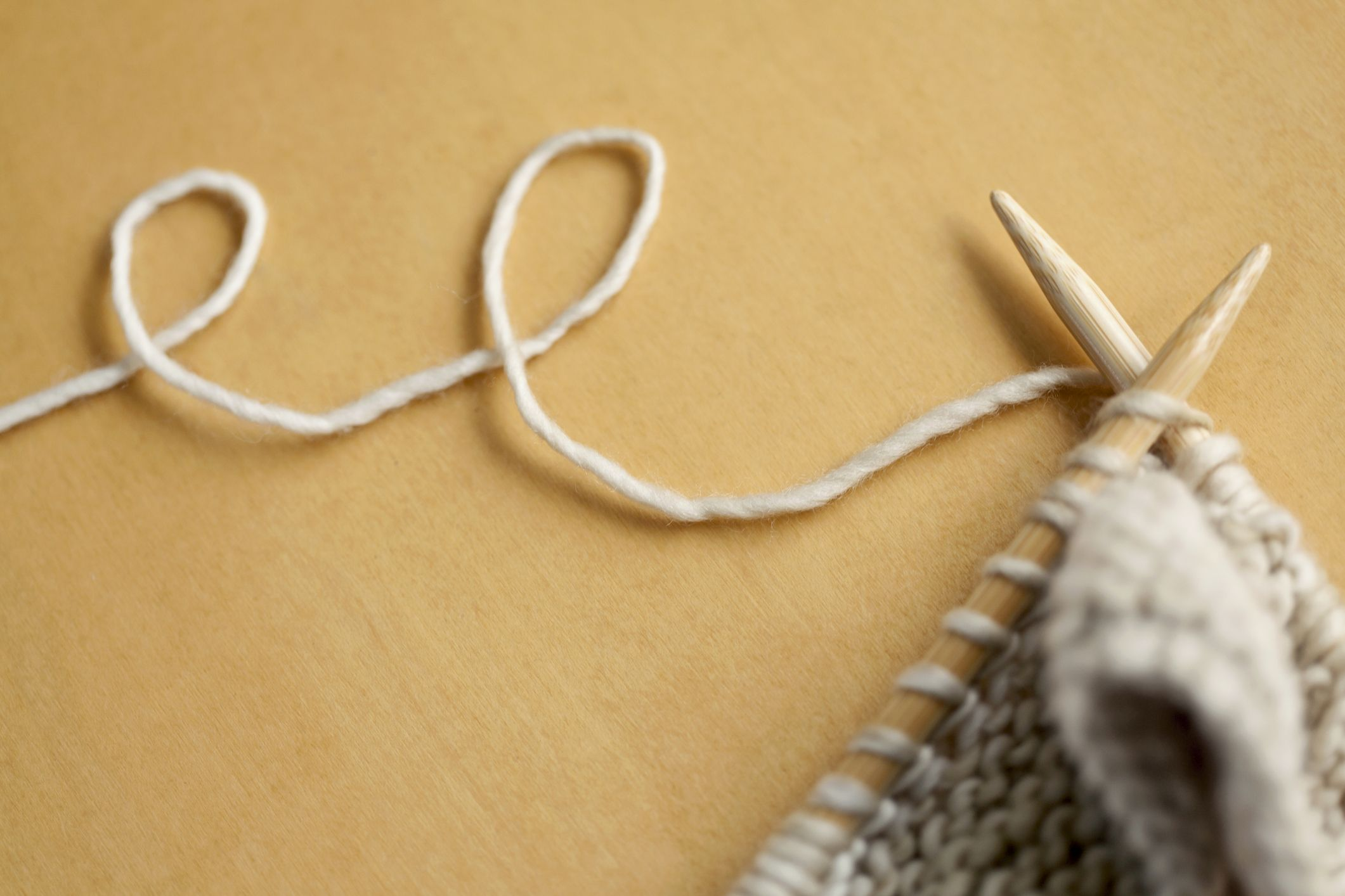 line of wool string connected to knitting project royalty free image 103416225 1554882512