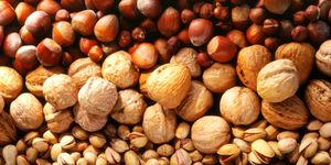 Lines of asssorted nuts - full frame