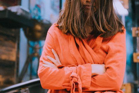 Blue, Orange, Yellow, Beauty, Fashion, Sitting, Long hair, Photography, Street fashion, Outerwear,