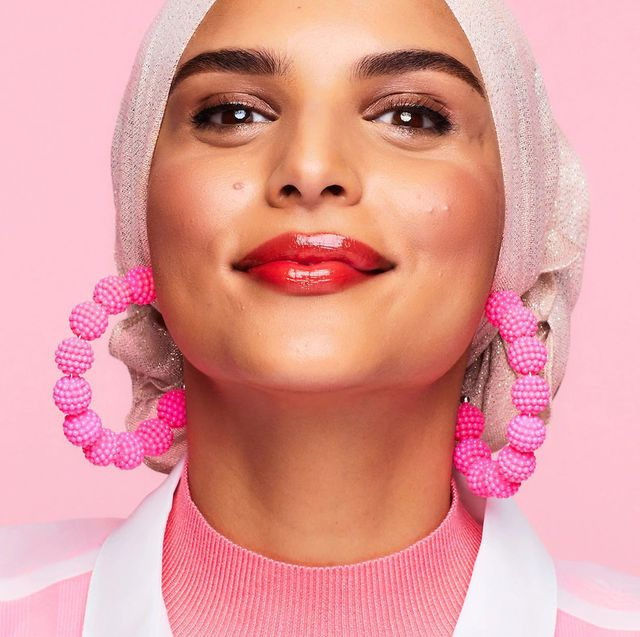 woman with glossy red lips and hoop earrings