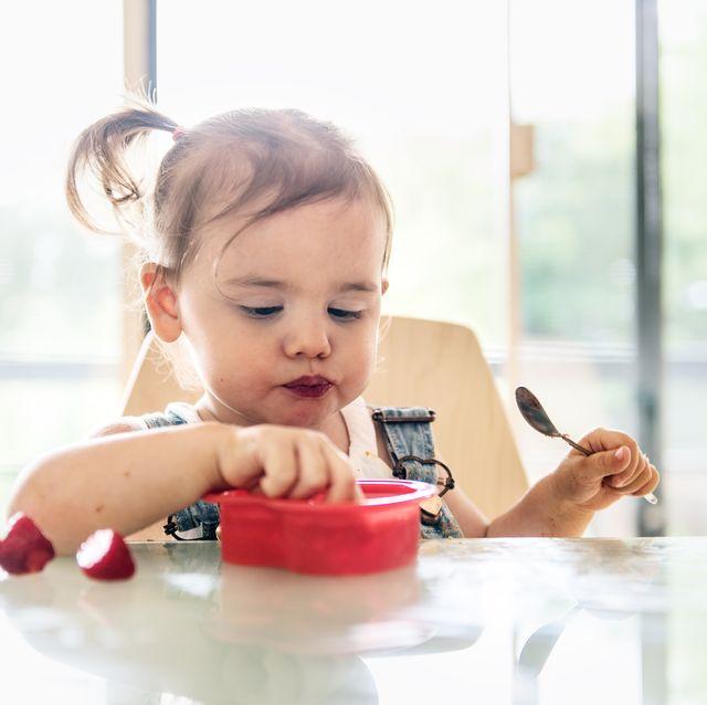 little 2 years old girl eating jello