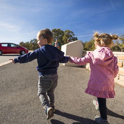 Little boy and girl walking hand in hand, Arizona, USA