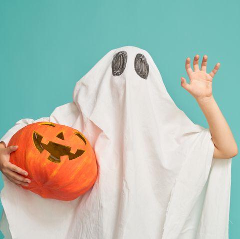 little kid in ghost costume