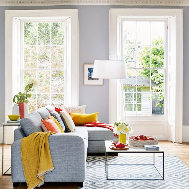 grey sofa and light grey walls in living room