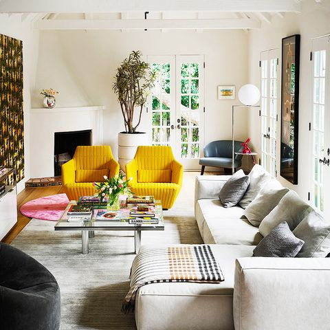 large white living room with yellow chairs and sectional