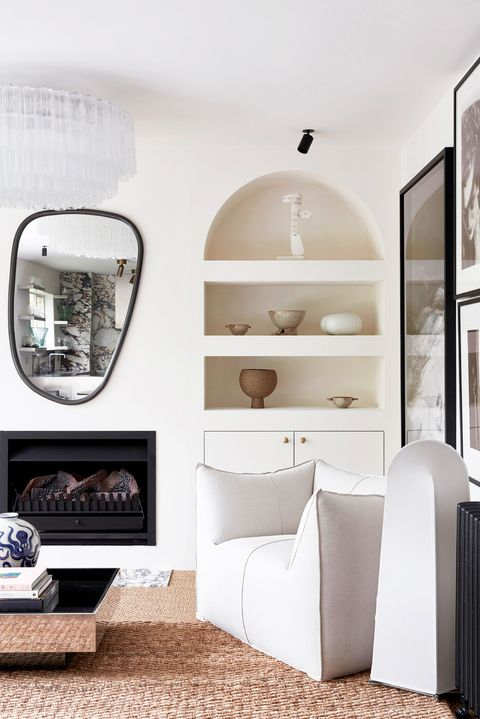 modern minimalist living room with avant garde mirror