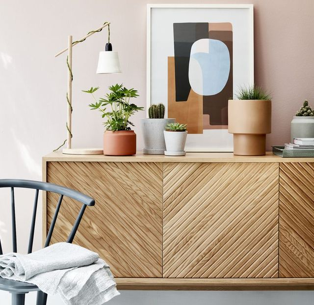 living room sideboard with small houseplants