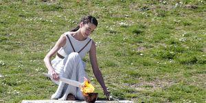 Encendido de la llama olímpica en Olimpia
