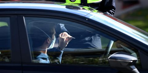 local police control people's movement in a traffic checkpoint in the town of majadahonda