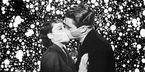 Couple kissing wearing masks
