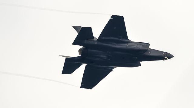 a lockheed martin f 35 lightning ii flies during a military